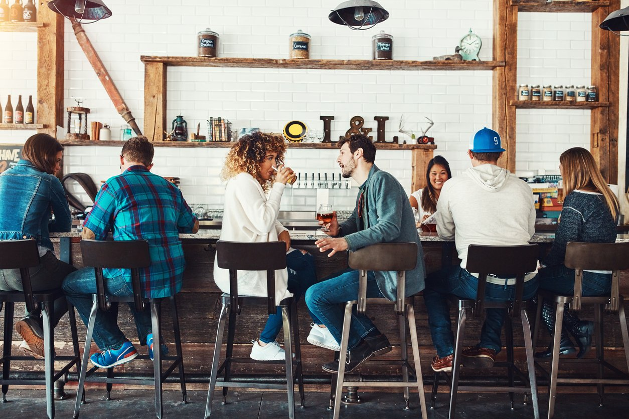 People sitting in a restaurant at the bar, open a restaurant concept